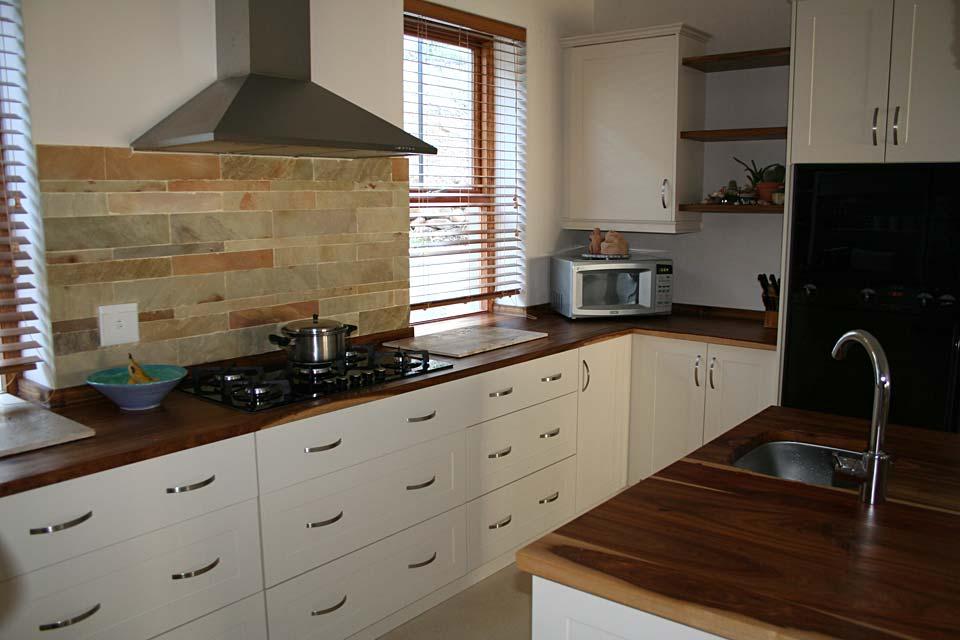 Satin Jasmine Shaker-Style Cabinetry with Kiaat work surfaces