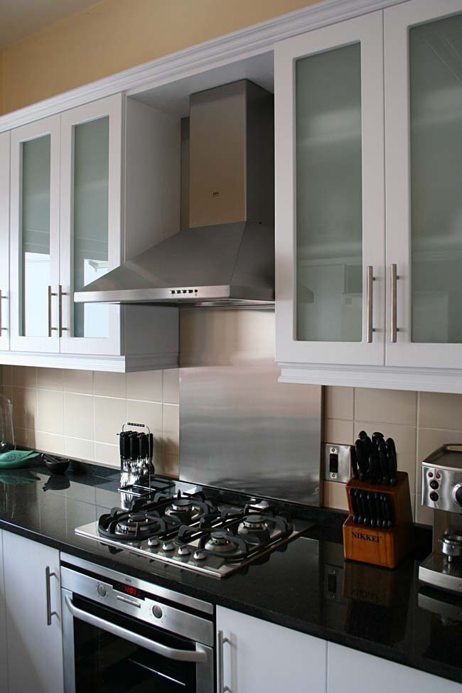 White Woodgrain PVC-wrap Cabinetry with Rustenberg Work Surfaces
